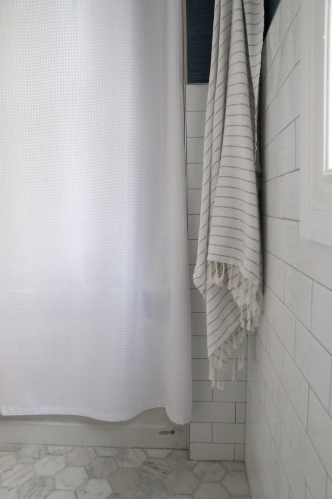 White hex marble tile in kid's bathroom - by Jaclyn Harper from Harper Designs