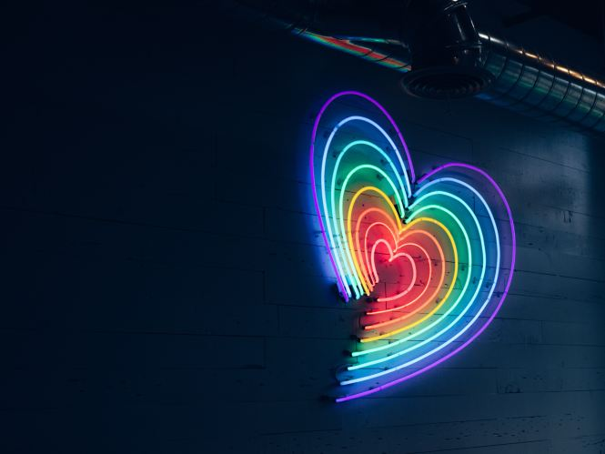 Image: A rainbow heart made of fluorescent lights. Representing LGBTQ Pride.