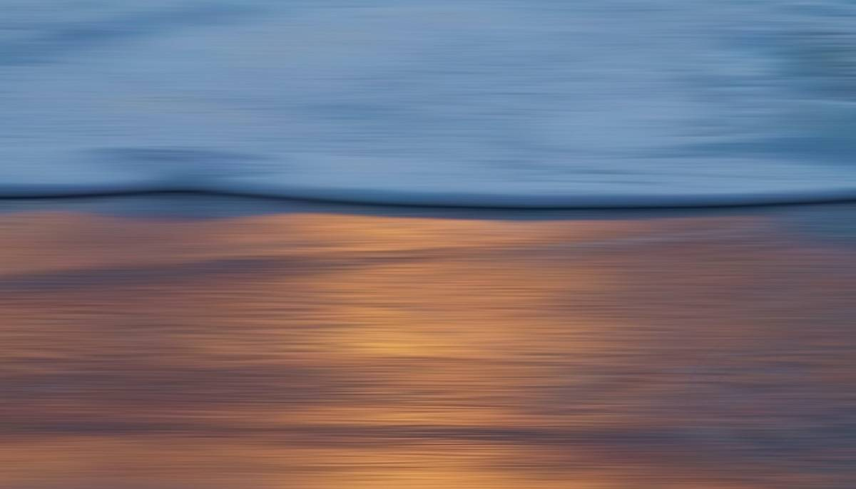 Autumn Sunset (3) - A beautiful autumn evening, enjoying a sunset over the sea and looking at the surf, it's as if the foam of the breaking waves brings the colors to land, where they then submerge in the cool, wet sand. - Impressionistic fine art seascape photography by Jacob Berghoef