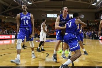 UNC Asheville players celebrate after a major fourth quarter block.
