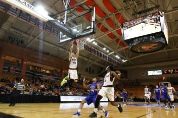 Jimmy Gavin threw down a rare dunk during the quarterfinal round against Presbyterian College. Jacob Hallex/ The Johnsonian