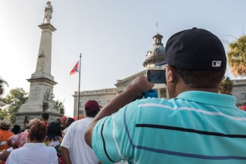 The last day of the Confederate Flag flying at the South Carolina State House drew thousands of on lookers. Many were out to take pictures of the flags last days flying over the State House.