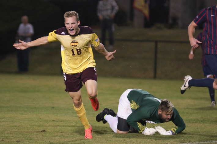Max Hasenstab celebrates after scoring a hat trick against Liberty University.