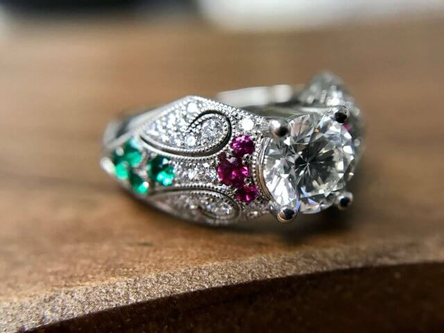 vintage style platinum ring with gemstones and diamonds
