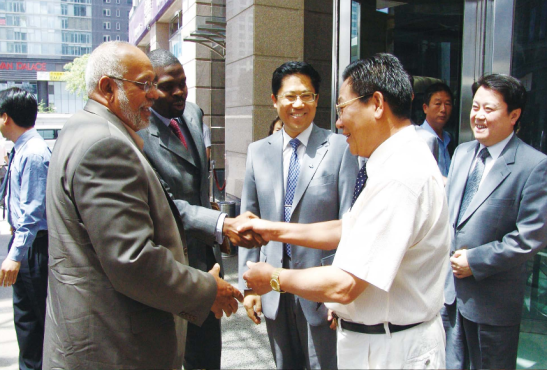 Donald Ramotar and Chairman of Bai Shan Lin Chu Wenze in China