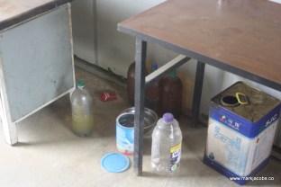 bottles of strange looking liquid in food area