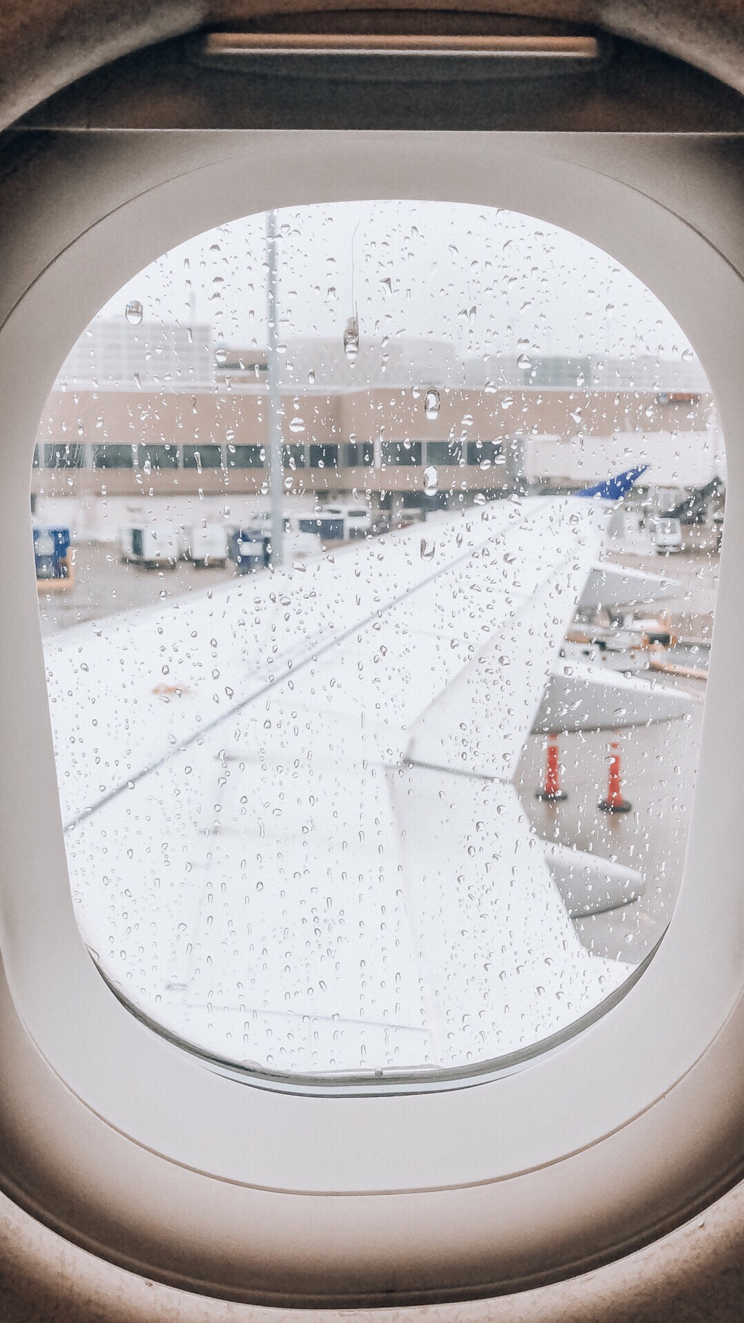 Gazing out a rain splattered airplane window and thinking of shuffling airports and an international flight scare!