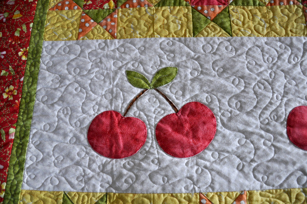 Cherry Quilt Jacquelynne Steves, machine applique, fruitful hands fabric, cherry quilt pattern