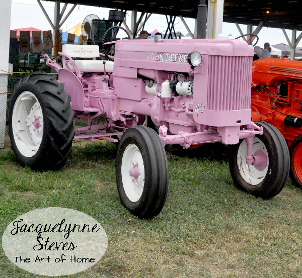 What country girl wouldn't want her own pink John Deere tractor?!