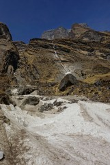 Snowslide with water fall just above