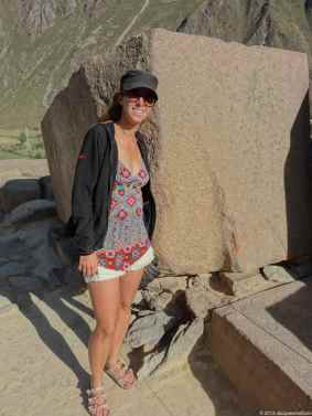 Caroline in front of a massive stone block at the temple Hill in Ollantaytambo
