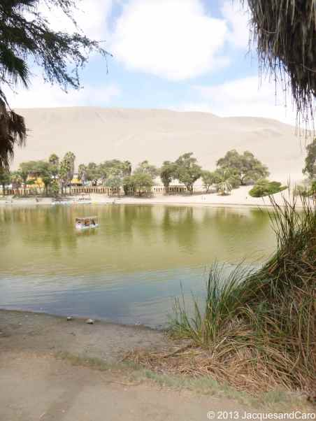 "The small ""lake"" in the centre of Huacachina… green colour..."