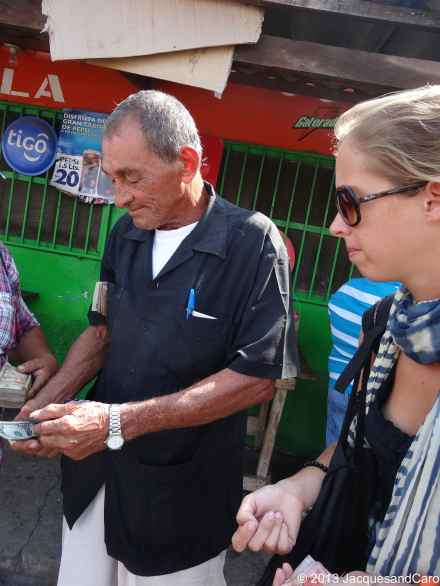 Changing money at Salvador border. Caroline is tough with the guy...