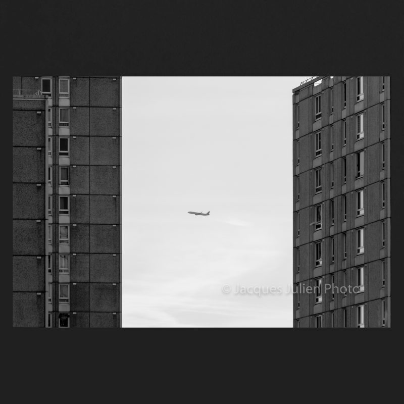Plane between buildings