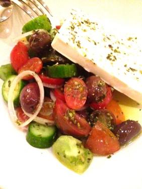 Village salad of cucumber, heirloom cherry tomatoes, olives, feta