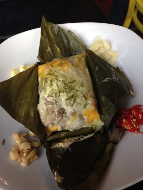 Fermented mince pork in banana leaf