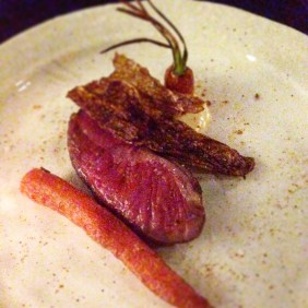 Sous vide lamb rump dressed with smoked lamb fat, charcoal emulsion, South Indian spice blend, cabbage