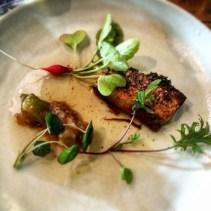 Pork belly, concentrated pork stock, green tomato and apple chutney, radish seedlings, kale seedlings nasturtium and sheep sorrel