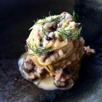 Tagliolini with sardine, raisins, Montasio and fennel