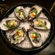 Oyster with pickled cucumber and flying fish roe