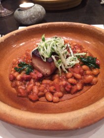 Slow cooked pork cheek, haricot beans, chorizo, apple and fennel
