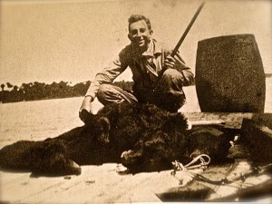 "Mr Reginald Waters with black bears killed on Hutchinson Island, around 1930.  (Photo credit Sandra Thurlow, Sewall's Point,"" A History of a Peninsular Community on Florida's Treasure Coast""/Reginald Waters Rice)"