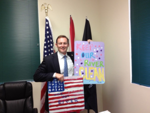 Newly elected Patrick Murphy holds River Kidz signs in 2013.