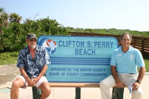 Brothers, Chris and Mark Perry sit on the bench along Hutchinson Island that is  in honor of their father, Clifton Perry. (Photo Sandra Thurlow, ca. 2000.)