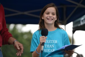 River Kidz member, Veronica Dalton, speaks, protest for SLR/IRL, St Lucie Locks, and Dam, 2013. At this event she spoke before more than 5000 people. (Photo Sevin Bullwinkle)