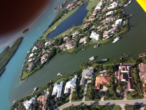Long shot of Sailfish Point marina with runoff clearly seen.
