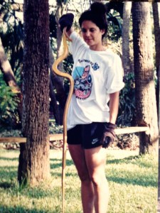 Me holding rat snake that was returned to the bushes.