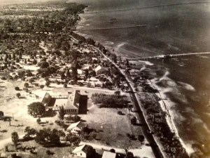 "1943 aerial photograph of the Jensen School and today's downtown Jensen with the wooden Jensen Bridge. As shown on page 20 of ""Historic Jensen Beach and Eden on Florida's Indian River,"" by Sandra Thurlow-Henderson, 2004."