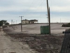 Langford home stands on barren hill. (Photo JTL)