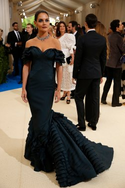 This gown worn by Katie Holmes is elaborately elegant. And the colour compliments the design perfectly.