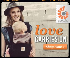 Woman carries young child in an Ergobaby carrier