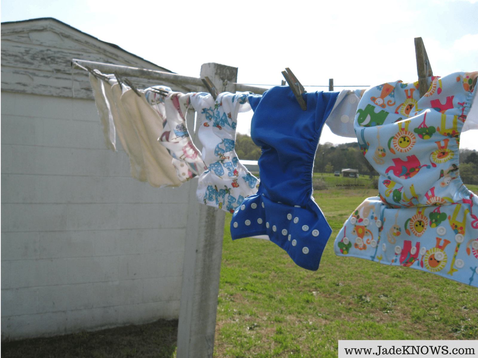 Cloth pocket diapers and inserts dry on a clothesline