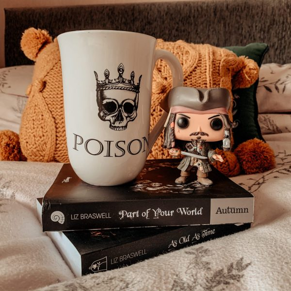 Part Of Your World Book with a Jack Sparrow Pop! and Poison Cup on top