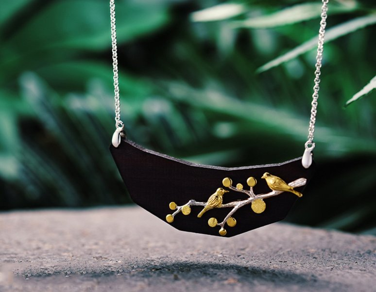 https://www.lotusfun.com/products/birds-on-branch-wood-necklace