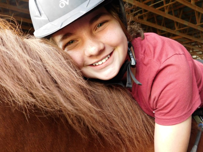 My name is Alayna and I am an equestrian. I currently own Neville, a 2007 Miniature Horse and my family owns Avery, a 2005 Morgan cross. Currently, I am taking riding lessons once a week. Eventually, I'd like to show Avery in dressage classes. I'm a homeschooled violinist, but I play guitar as well! I volunteer at a therapeutic riding center and I get to help with barn chores and lessons. Our Avery is boarded there, so I get to spend most of my Wednesdays there! I have my own YouTube channel as well, and it would be great if you could subscribe and share it! I am still needing 100 subscribers for a custom URL! When I'm not editing videos, writing or working with my ponies, I'm either drawing or taking pictures of my ponies! I am an amateur equine photographer (I practice on my lovely ponies!) and I take my pictures with a Nikon Coolpix L840, which I highly recommend. I attend church every Sunday morning and I am involved in my Youth Group. In time, I'm going to get back into 4-H in March of 2017, which I'm super excited about! The picture above was taken by my beautiful Aunt Jenna, who is an amazing photographer! This was from the photoshoot she did of me and Neville in October of 2016. She does an awesome job!