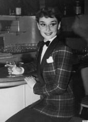 Actress Audrey Hepburn (1929 - 1993) dines out in London's West End, wearing a tartan jacket and bow tie, 3rd October 1950. (Photo by Keystone/Hulton Archive/Getty Images)