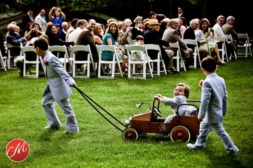 child being pulled by his brothers in vintage toy car at wedding, awarded Masters