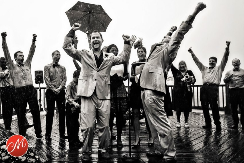 groom with groom after marriage with rain