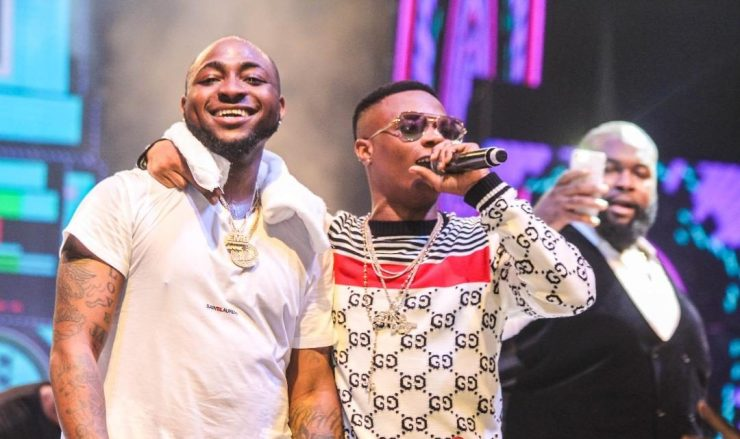 Related image top 5 reasons that proves davido is the most dedicated musician in nigeria TOP 5 REASONS THAT PROVES DAVIDO IS THE MOST DEDICATED MUSICIAN IN NIGERIA Davido Wizkid 3 e1544119515747