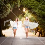 stock-photo-19950717-two-beautiful-healthy-young-women-going-for-a-surf-together