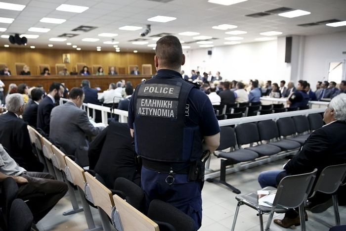 A police officer stands guard at the court room where the trial of members and leaders of Greece's far-right Golden Dawn party takes place, in Koridallos prison, near Athens