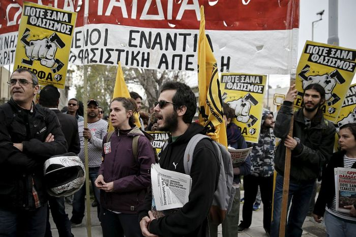 Protesters shout slogans during an anti-fascism demonstration outside of Koridallos prison where the trial of members and leaders of Greece's far-right Golden Dawn party takes place in Athens