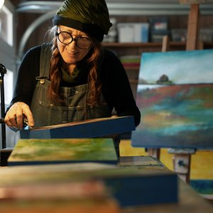 Jaime Byrd painter painting oil and cold wax in art studio Asheville, NC