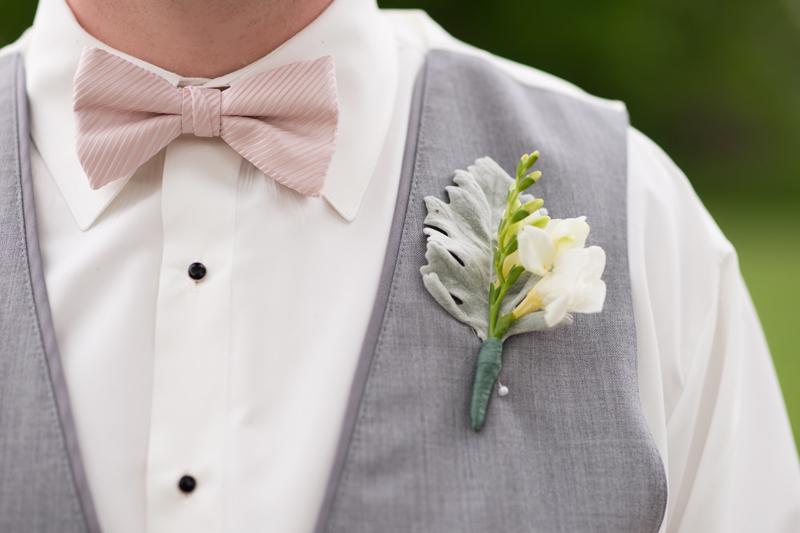 pink bowtie gray vest