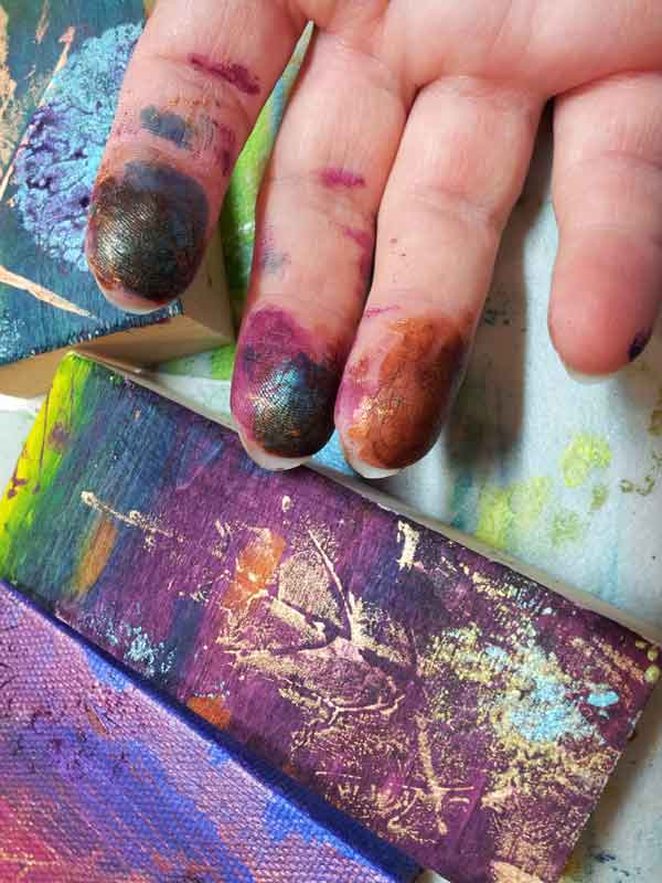 fingers with paint on them