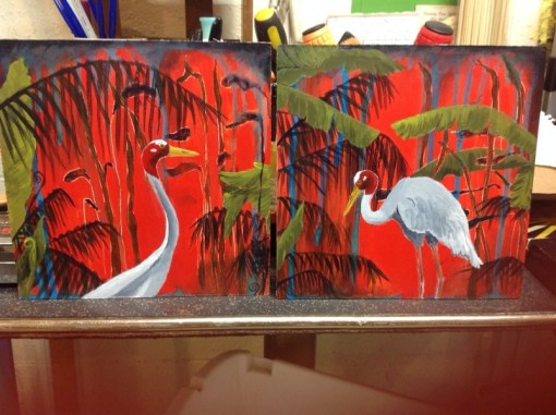 2 paintings as a set called Cinnabar Nights of Love 1 & 2 - Sarus cranes with red tropical backgrounds with palms, ferns and jungle leaves